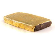 A bar of legal hash covered with a film of gold