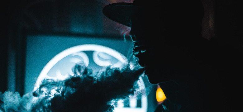 Man using a CBD hash vaporizer